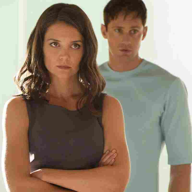 Katie Holmes (left) and Alexander Skarsgard play Jonas' parents, who support the efforts of The Giver's dystopian government.