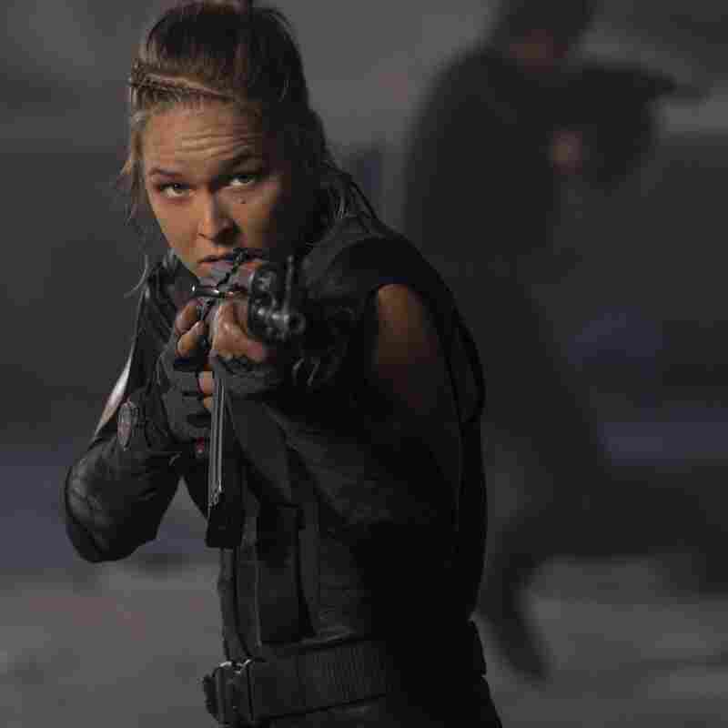 Ronda Rousey plays Luna, a former club bouncer skilled in physical combat.