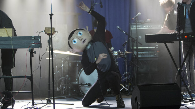Michael Fassbender stars as Frank, the mysterious papier-mache head-wearing lead musician of an offbeat pop band called Soronprfbs in Lenny Abrahamson's Frank.