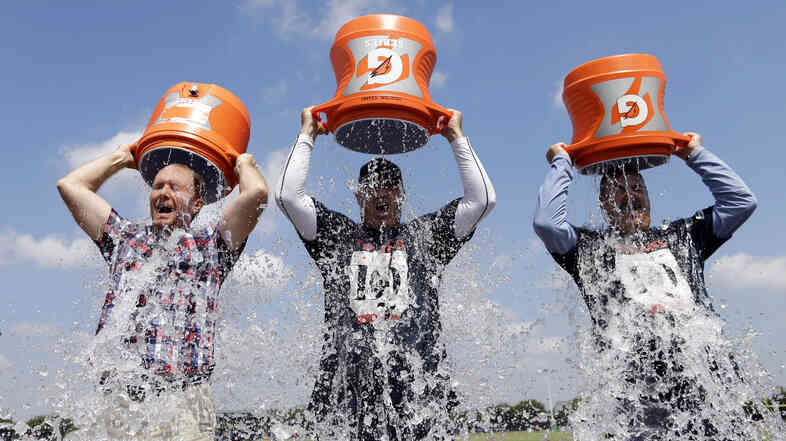 Houston Texans Coach Bill O'Brien (center) Chief Operating Officer Cal McNair (right) and Houston Chronicle reporter Brian Smith take the ALS Ice Bucket Challenge Thursday to raise money for the ALS Association.