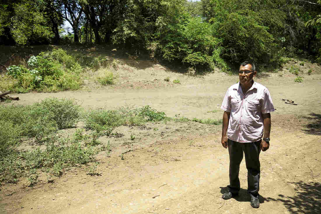 Santos Nicoya Bonillo stands in the dry Brito riverbed. Nicoya heads a farmer's cooperative in Tola, Nicaragua. The proposed canal route is set to start at the mouth of the Brito river on the Pacific Ocean. This is the third year of a major drought in southern Central America.