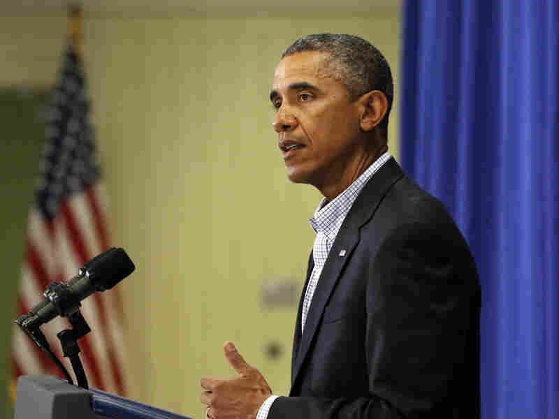 President Obama speaks to reporters Thursday about the police shooting of 18-year-old Michael Brown in Ferguson, Mo.
