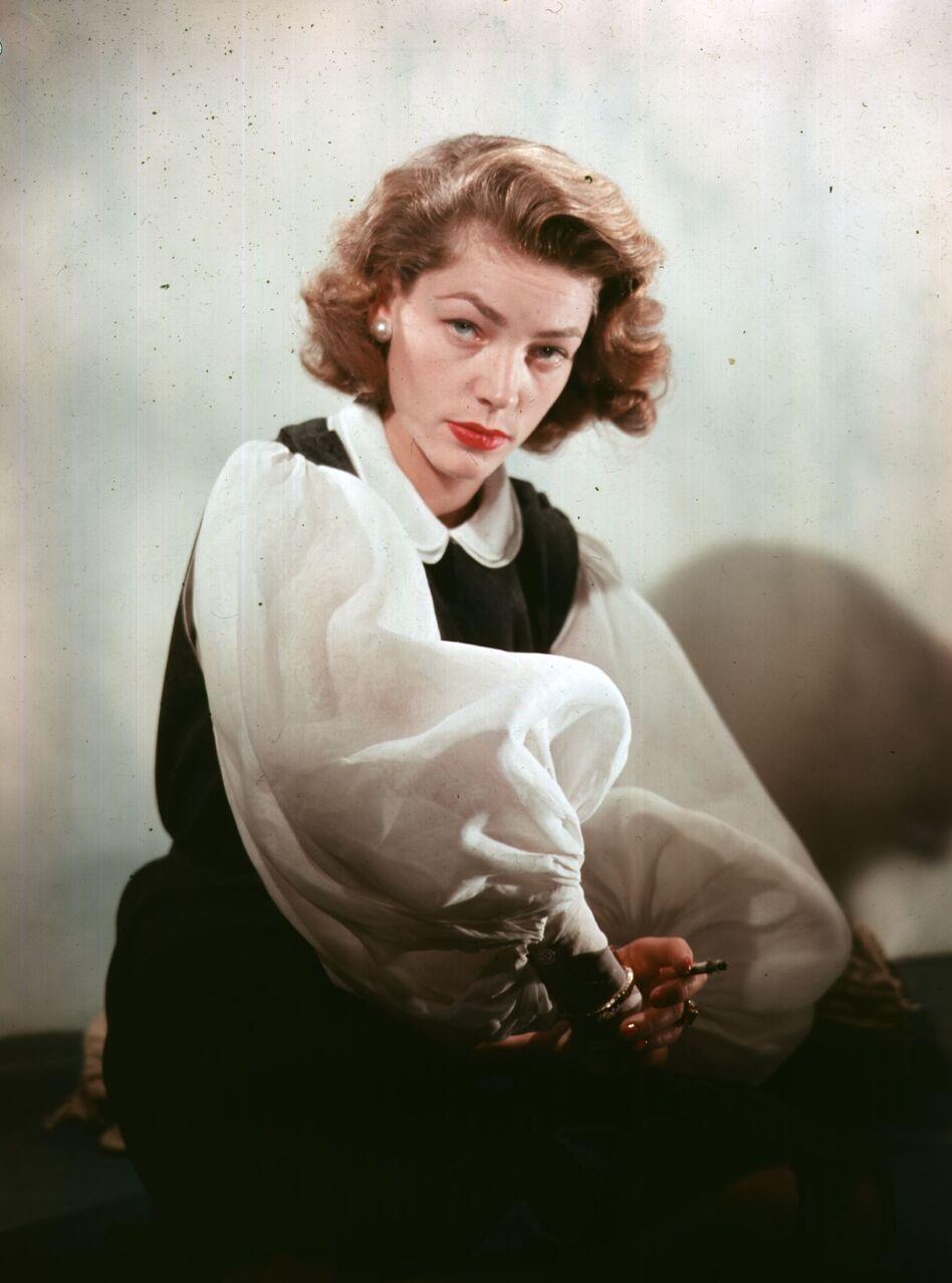 """Lauren Bacall says she never set out to have a <em>look.</em> """"It was just a way to keep my head steady,"""" she insists. (Baron/Getty Images)"""