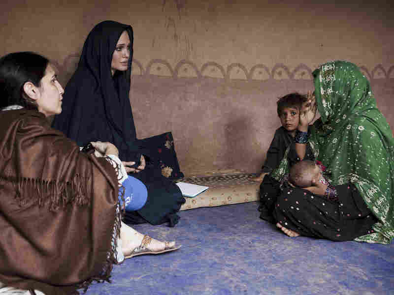 Angelina Jolie visits a displaced family at an Afghan Resettlement Camp in Islamabad, Pakistan.
