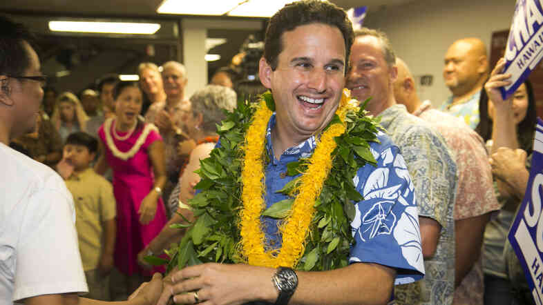 Sen. Brian Schatz is greeted by supporters as he enters his campaign headquarters on Aug. 9 in Honolulu.