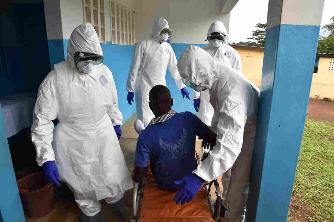 Health workers at the district hospital in Biankouma, Ivory Coast, practice handling potential patients with Ebola.