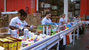 Volunteers at the Maryland Food Bank in Baltimore sor