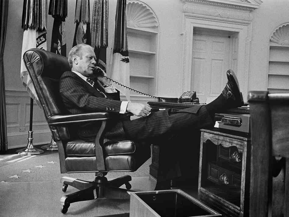 President Ford gets down to business in the Oval Office of