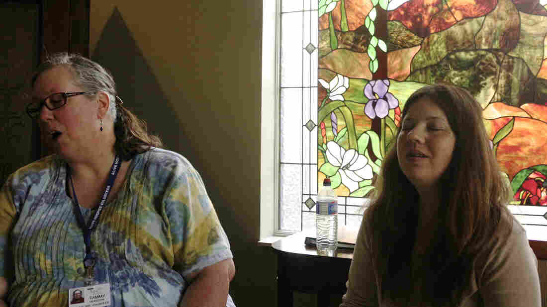 Tammy Heinsohn (left) and Carolyn Wilson sing in the meditation room of Alive Hospice in Nashville. They're part of the Threshold Choir, which sings to the dying.