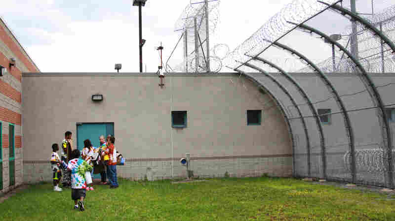 Hope House campers wear tie-dye shirts they made to the last day of camp at Western Correctional Institution in Cumberland, Md.