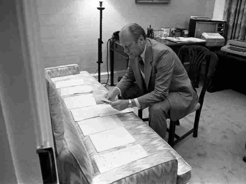 President Ford examines documents related to potential vice presidential nominees on August 15, 1974.