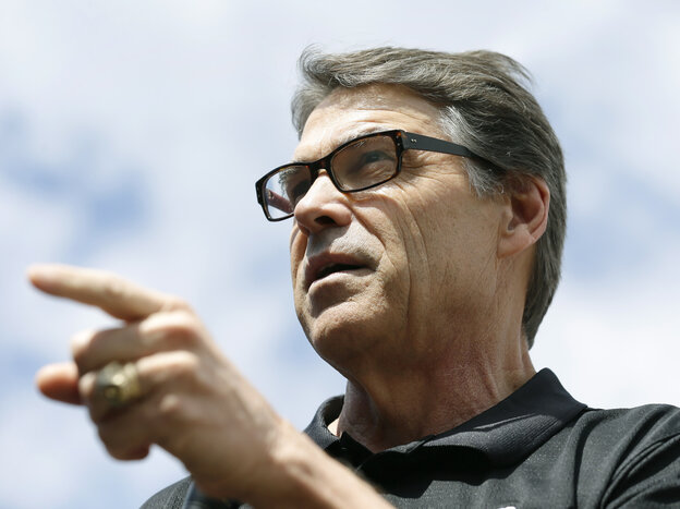 Texas Gov. Rick Perry speaks at the Des Moines Register's Political Soapbox at the Iowa State Fair on Tuesday. Late Friday, Perry was indicted on abuse-of-power charges.
