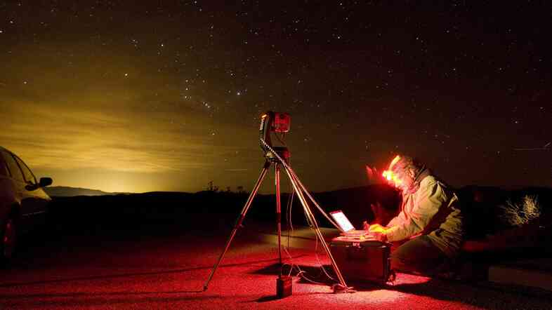 Dan Duriscoe works at a special computer-controlled camera used to photograph the night sky at Dantes View in Death Valley National Park in California.