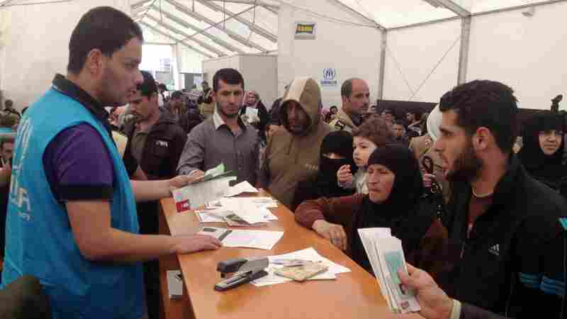 A picture taken with a smart phone shows Syrian refugees queuing at one of the many UNHCR (United Nations Refugee Agency) registration centers in Lebanon. At the same time that civil wars and the Ebola outbreak are plaguing countries in Africa, Syrian and Iraqi refugees are seeking help from agencies.