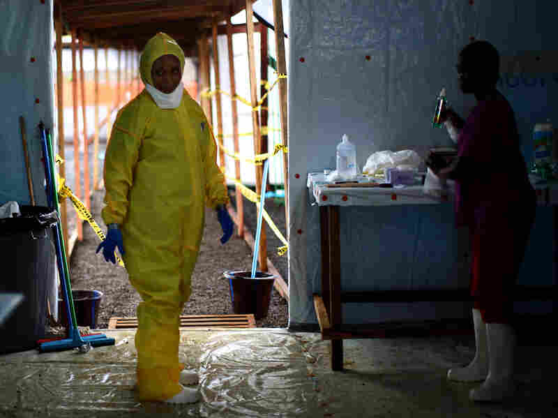 A nurse dons protective gear before entering the new Ebola treatment facility in Monrovia.