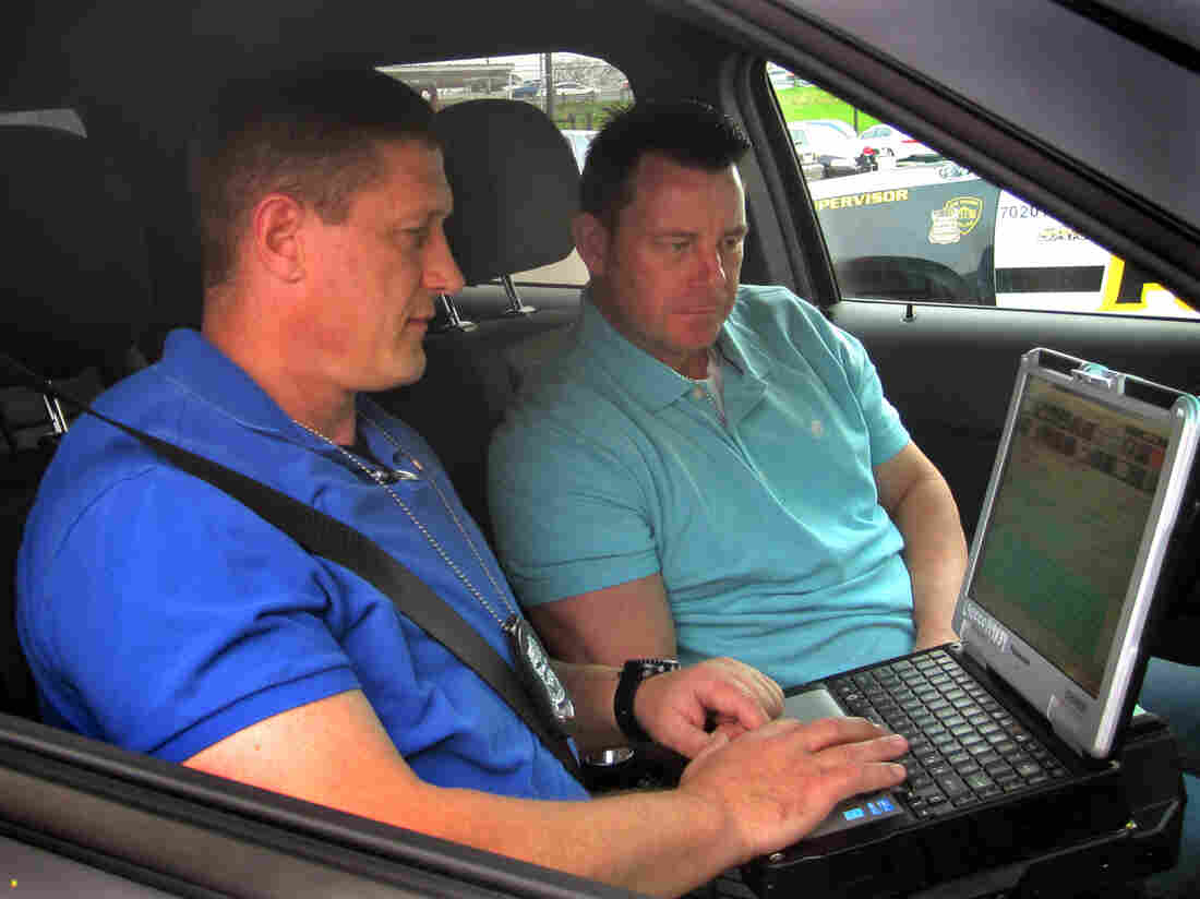 Officers Ned Bandoske (left) and Ernest Stevens are part of San Antonio's mental health squad — a six-person unit that answers the frequent emergency calls where mental illness may play a role.
