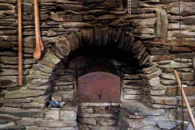 The fieldstone covering of their wood-fired oven.