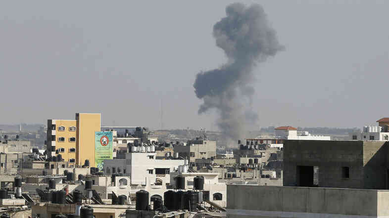 Smoke is seen after what witnesses said was an Israeli airstrike in Gaza City on Tuesday. Israel launched attacks in the Gaza Strip and recalled its negotiators from truce talks in Cairo after saying three Palestinian rockets had hit southern Israel, hours before a cease-fire was due to expire.