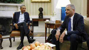 President Barack Obama meets with Attorney General Eric Holder in the Oval Office of the White House on August 18, 2014.