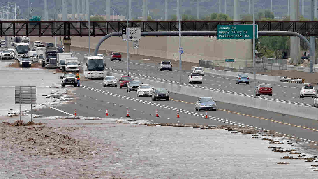Flash-flood waters from the overrun Skunk Creek flood I-10 in northwestern Phoenix. Flooding from heavy rain forced authorities to close several major roads, including a portion of Interstate 17.
