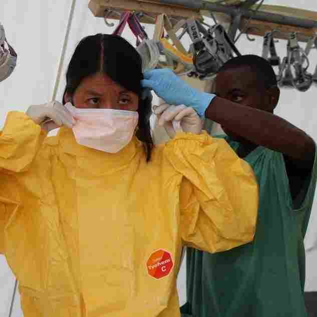 Joanne Liu, MSF International President, gets suited up at an Ebola treatment center in Kailahun, Sierra Leone.