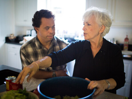 Justin and his mother, Annamarie McCowan, make a salad together.