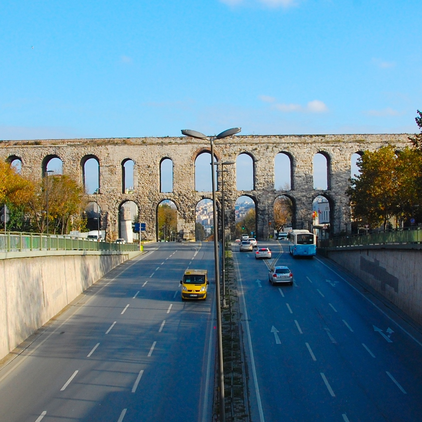 Traffic passes under Istanbul's ancient Valens Aqueduct, which once carried water to the city's royal cisterns.