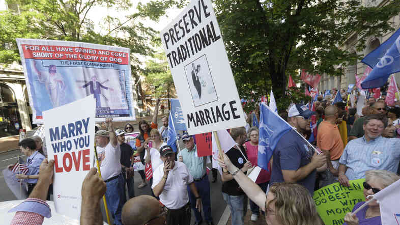 Supporters and opponents of gay marriage demonstrate outside the federal appeals court in Richmond, Va., in May.