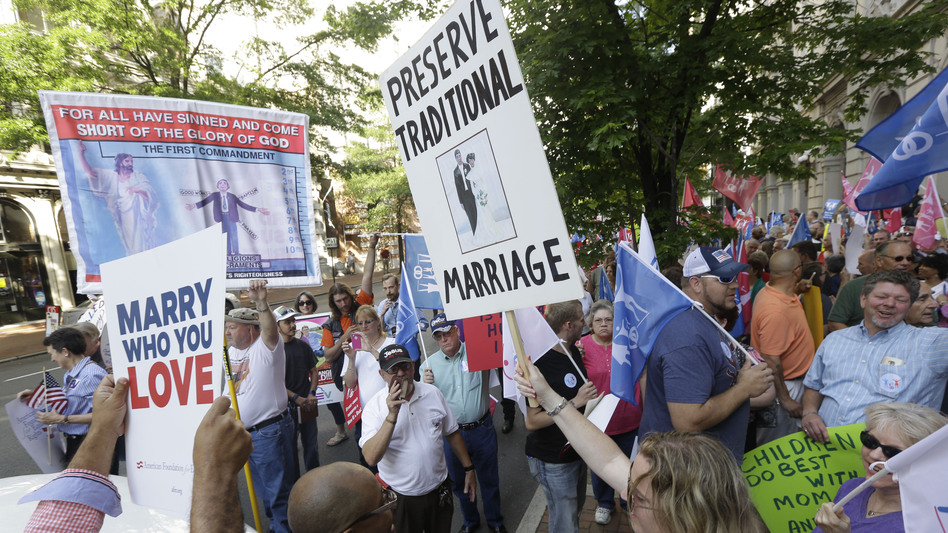 Supporters and opponents of gay marriage demonstrate outside the federal appeals court in Richmond, Va., in May. (AP)