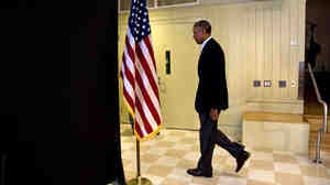 President Obama leaves after making a statement Wednesday about the killing of journalist James Foley in Syria. The president said the U.S. would continue to confront Islamic State extremists despite the brutal murder.