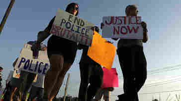 People march Wednesday in Ferguson, Mo., to protest the shooting of Michael Brown.