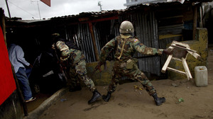 Another soldier throws a chair at protesters who had been hurling rocks.