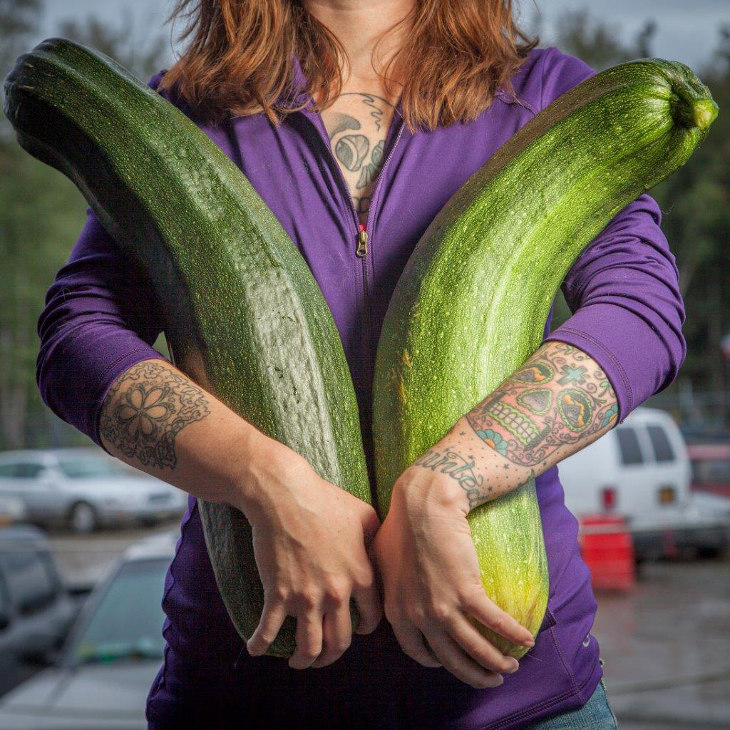 "Alaska grower Brittney Kauffman holds two zucchinis she entered in a giant vegetable competition in 2013. ""Alaska is just a hotbed for gardening, believe it or not,"" says Alaska State Fair crops superintendent Kathy Liska. ""Everybody thinks that we're always under ice -- no!"""
