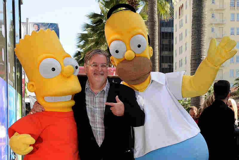 The Simpsons creator and cartoonist Matt Groening stands with Bart and Homer Simpson when they were honored with a star on the Hollywood Walk of Fame in 2012.