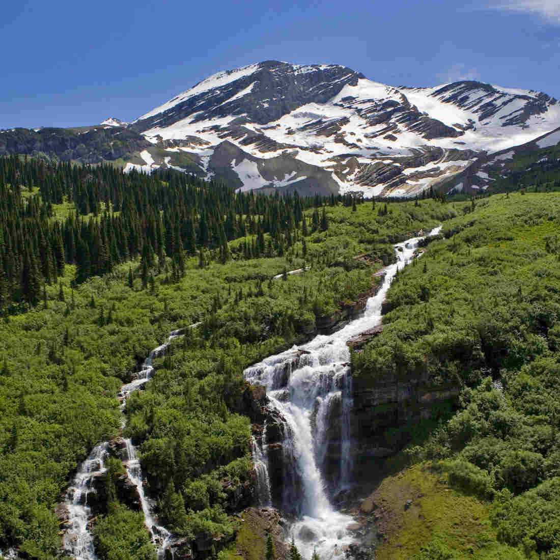 An earlier spring in Montana's Glacier National Park means full waterfalls at first — but much drier summers.