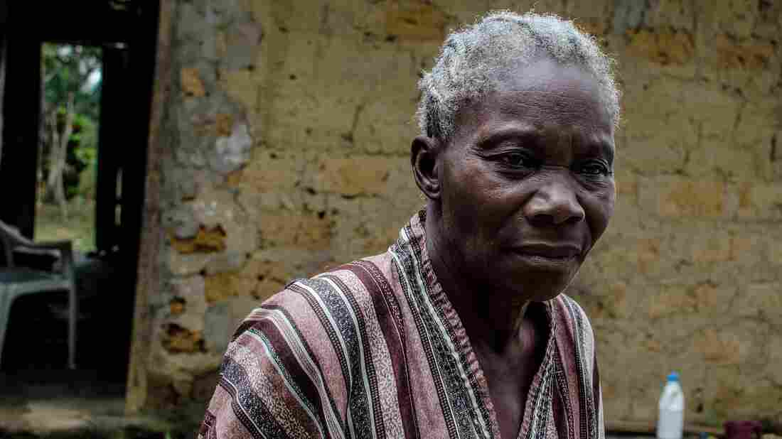 Amanda Ellis, 79, lost five members of her family to Ebola. Now, nobody will buy the mangoes that used to provide her income. She must rely instead on handouts.