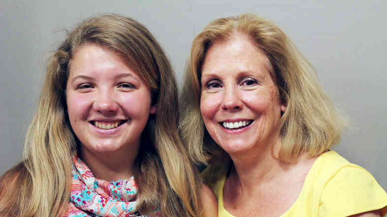 """Erika Kalberer (left) and her mother, Kris. Their family has been living in their car. Kris tells her daughter, """"I don't think sometimes you know how strong you are."""""""