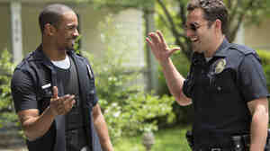 Duuuuuuude! Damon Wayans Jr. and Jake Johnson explore the whimsical fun of petty tyranny in Let's Be Cops.