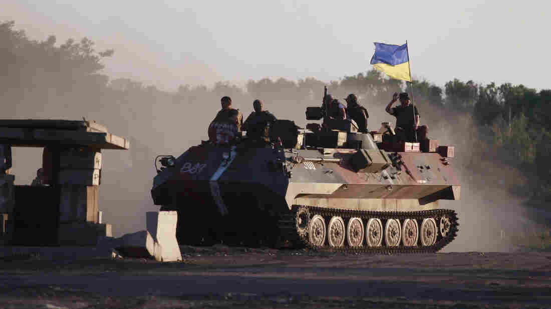 Ukrainian soldiers muster at a point close to Luhansk in eastern Ukraine on Wednesday, as Ukrainian troops make a push into rebel-held territory.