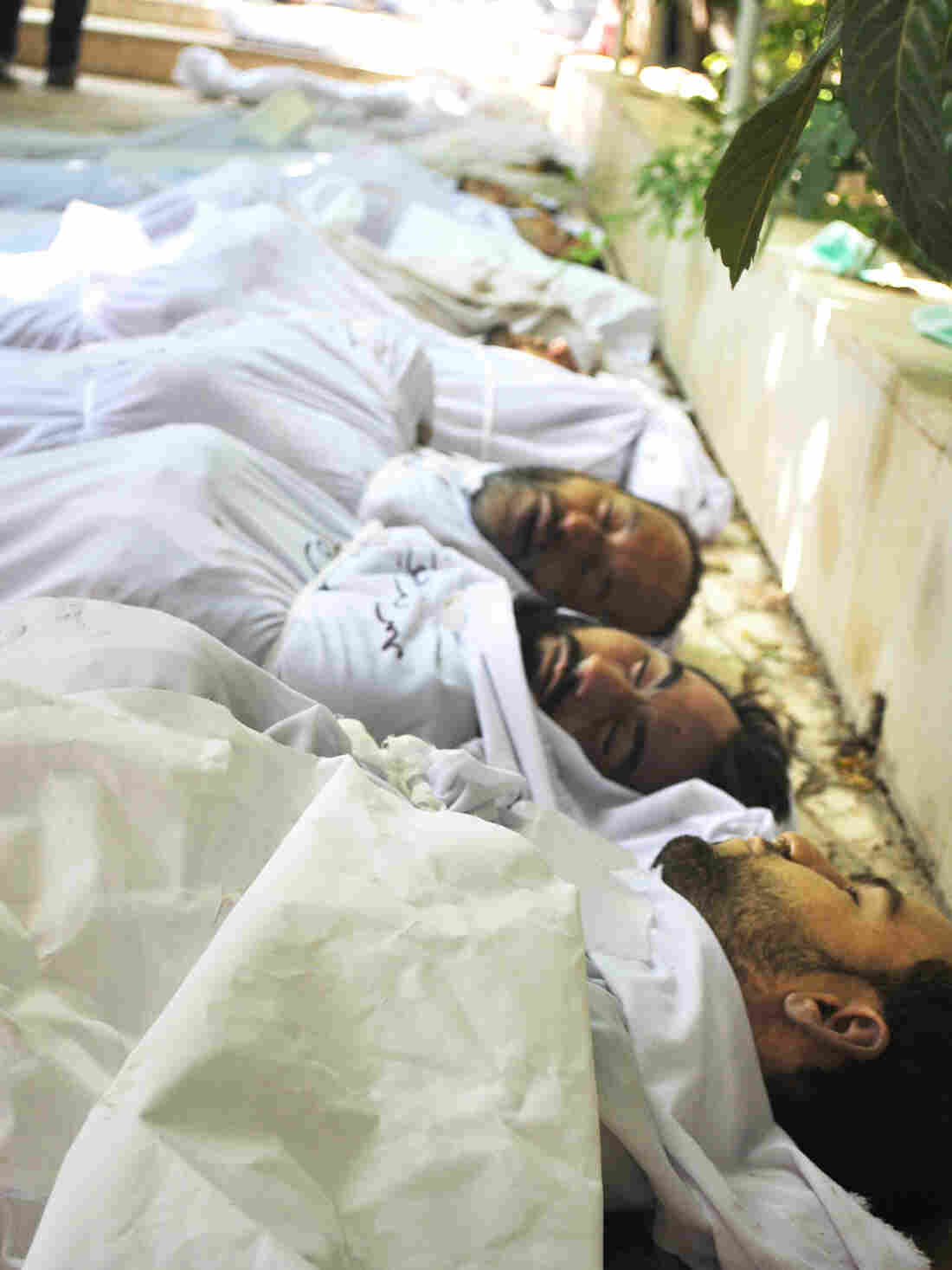 Syrians killed in a chemical weapons attack were taken to a field hospital in Eastern Ghouta, in the suburbs of Damascus, one year ago on Aug. 21, 2013. More than 1,400 people were killed in the attack blamed on the Syrian government, which continues to besiege the rebel-held area to this day.