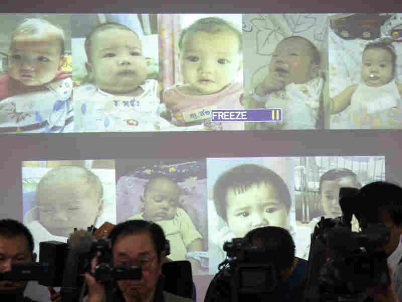 Surrogate babies that Thai police suspect were fathered by a Japanese businessman who has fled from Thailand are shown on a screen Aug. 12 during a news conference at the headquarters of the Royal Thai Police in Bangkok.