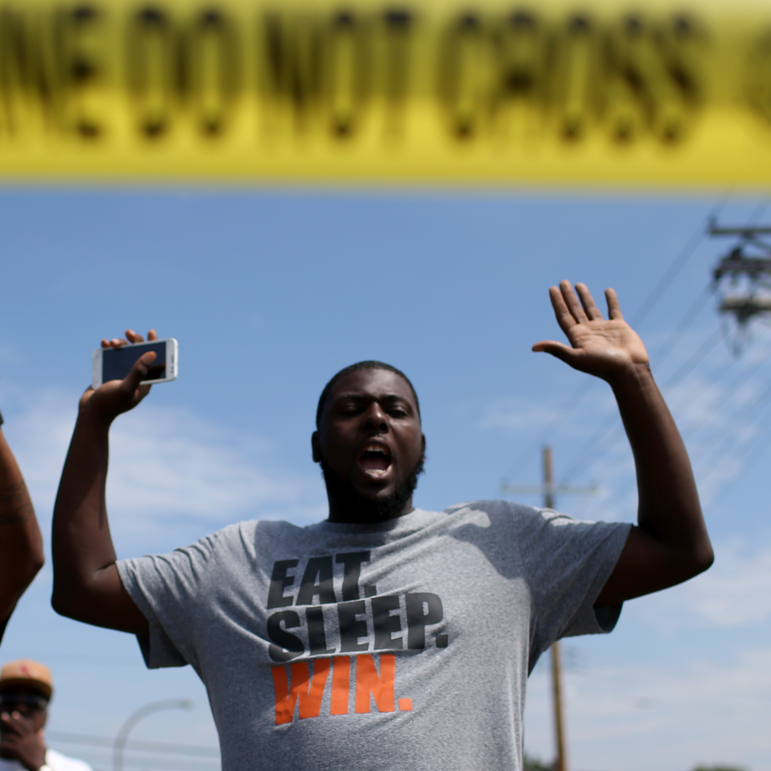 "The shooting of Michael Brown in Ferguson, Mo., also led to a series of protests. Many of them, like this protest on August 19, featured people raising their arms and chanting, ""Hands up, don't shoot."" But interactions between police and protesters were more tense -- and sometimes violent -- than in New York."
