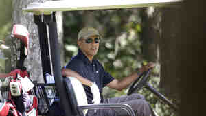 President Obama plays golf on the island of Martha's Vineyard in Massachusetts on Thursday.