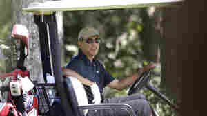 President Obama plays golf on the island of Martha's Vineyard in Massachusetts on Thursday.