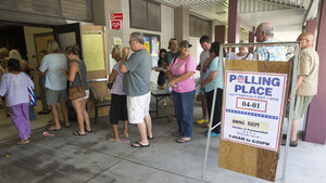 Voters crowd the cafeteria of the polling place held at Keonepoko Elementary School on Aug. 15, in Pahoa, Hawaii.