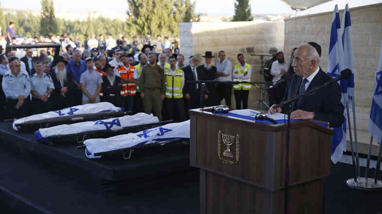 Israeli President Shimon Peres (right) eulogizes the three Israeli teens who were abducted and killed in the occupied West Bank, Gil-Ad Shaer, U.S.-Israeli national Naftali Fraenkel, both 16, and Eyal Yifrah, 19, during their joint funeral July 1 in the Israeli city of Modiin.