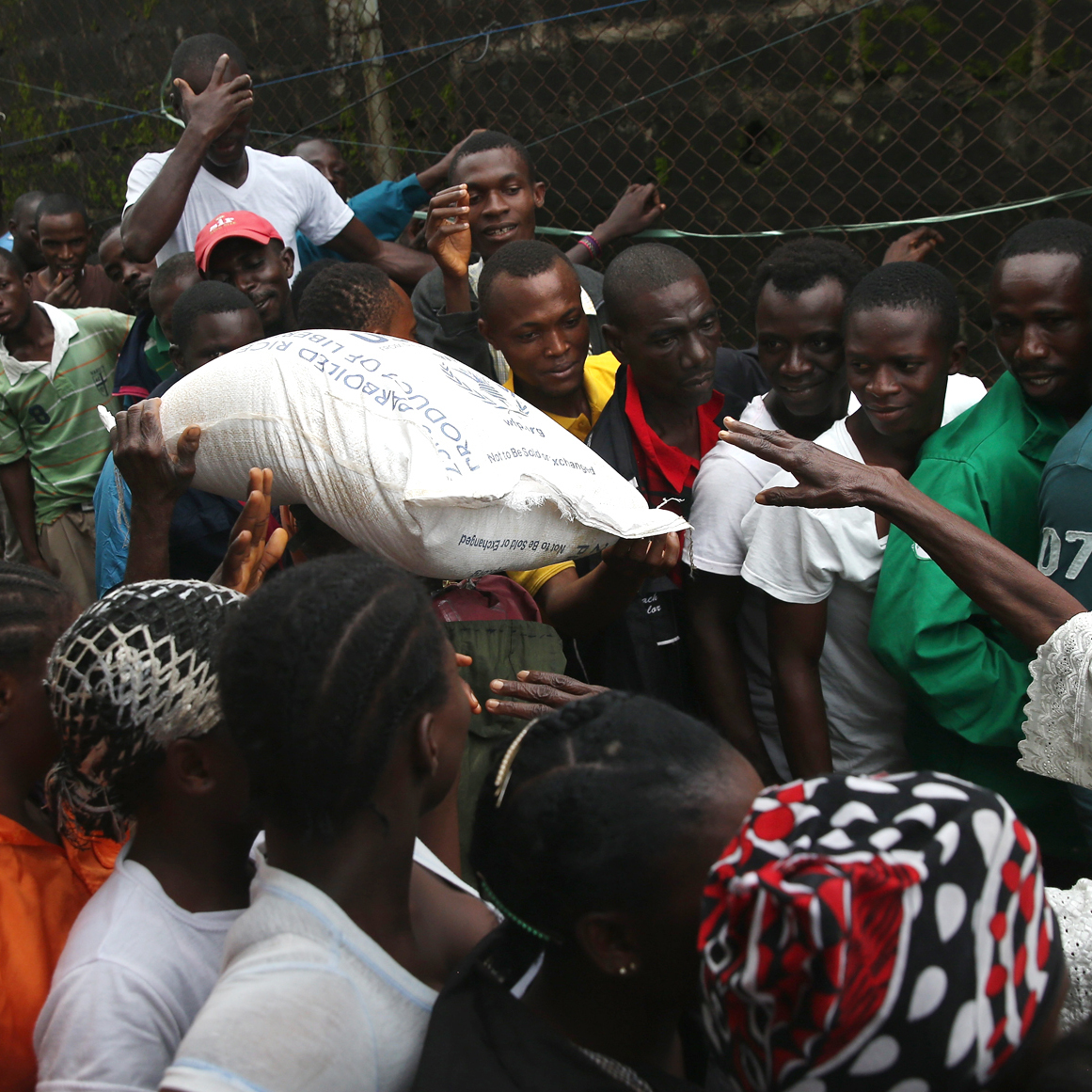 The Liberian government delivered bags of rice, beans and cooking oil to residents of the West Point slum in Monrovia. The community has been quarantined due to the Ebola outbreak in the area.
