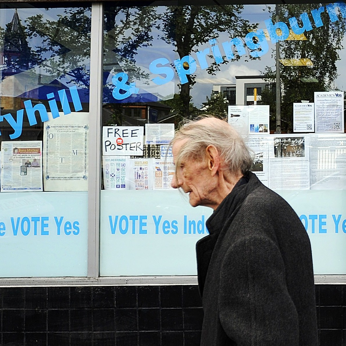 A pedestrian walks past the Yes Scotland campaign office in Glasgow on Aug. 19, ahead of the upcoming referendum on independence which will be held on Sept. 18. A majority of English people oppose Scotland continuing to use the pound if it votes to become independent.