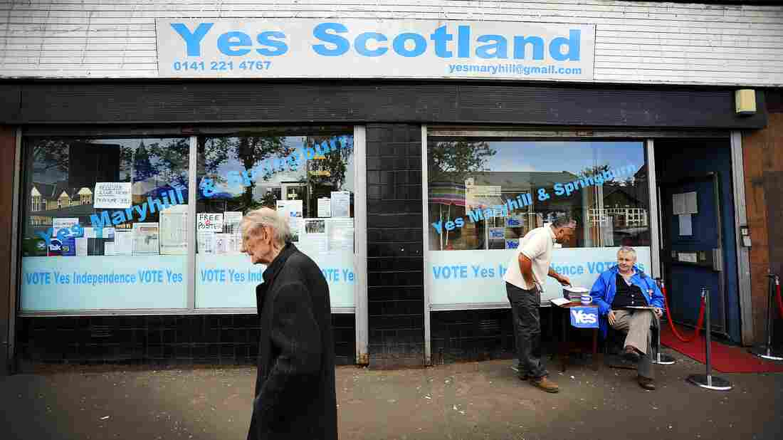 A pedestrian walks past the Yes Scotland campaign office in Glasgow on Aug. 19, ahead of the Sept. 18 referendum on independence. A majority of English people oppose Scotland continuing to use the pound if it votes to become independent.