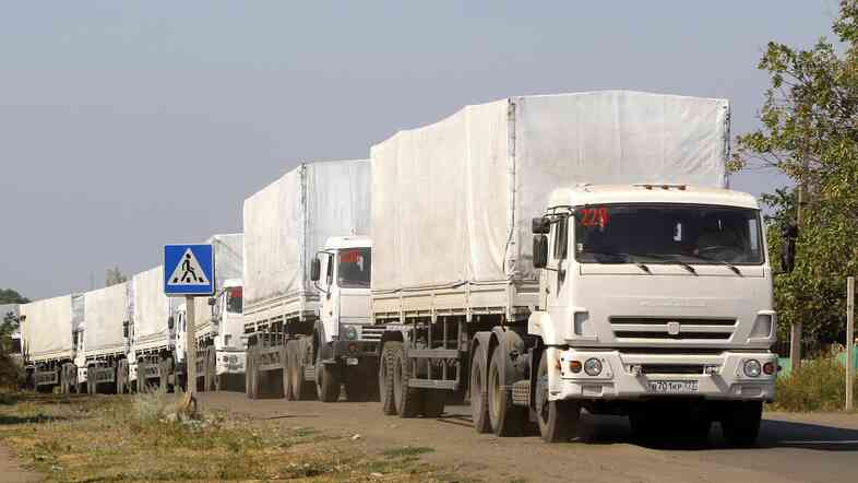 Trucks from a Russian aid convoy wait in line as they return to the Russian Rostov region town of Donetsk, Russia, on Saturday.